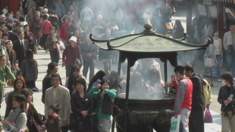 Visitors burn incense at the Senso-ji or Asakusa... Stock Video Footage