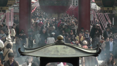 Visitors enter the famous gate of the Senso-ji or Asakusa Kannon-do Temple, located in Tokyo, Japan Footage