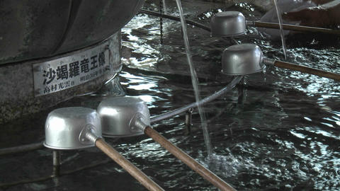 Water and ladles used in a purification ritual at the... Stock Video Footage