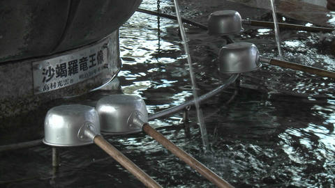 Water and ladles used in a purification ritual at the Senso-ji Temple complex in Asakusa, Tokyo, Jap Footage