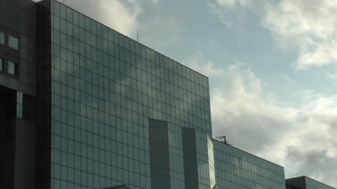 Time lapse of clouds reflected in the glass facade of the JR Station in Kyoto, Japan Footage