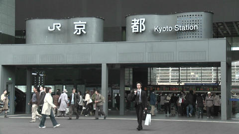 Commuters at the entrance to the JR Station, Kyoto, Japan Stock Video Footage