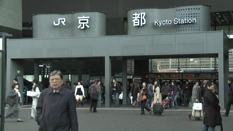 Commuters at the entrance to the JR Station, Kyoto, Japan Footage