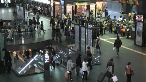 Commuters and turnstiles at the JR Station, Kyoto, Japan Live Action