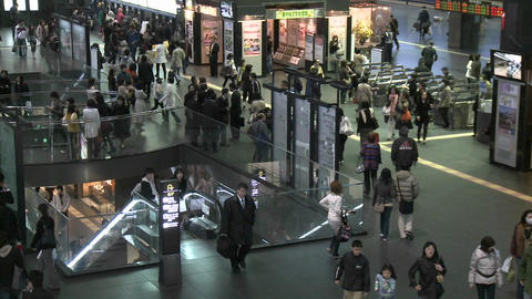 Commuters and turnstiles at the JR Station, Kyoto, Japan Stock Video Footage