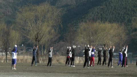 Morning exercises on the shore of Lake Kawaguchi-ko, a popular resort destination at the base of Mt Footage