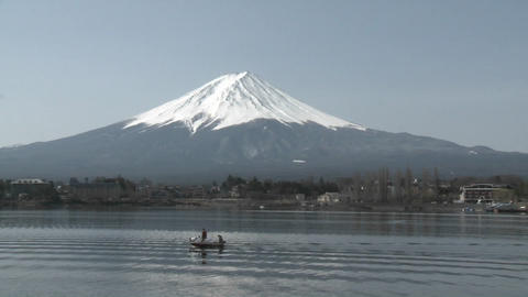 Mt. Fuji rises above Lake Kawaguchi and a small sport... Stock Video Footage