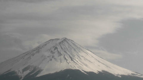 Time lapse of clouds ripping over the summit of Mt. Fuji, Japan Footage