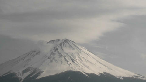 Time lapse of clouds ripping over the summit of Mt. Fuji,... Stock Video Footage
