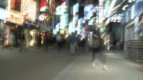 Slow motion, slow shutter speed clip of pedestrians in... Stock Video Footage