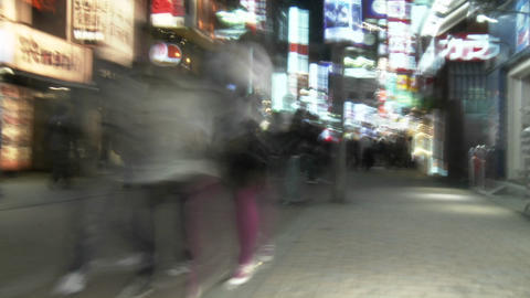 Slow motion, slow shutter speed clip of pedestrians in Shibuya, Tokyo, Japan Footage