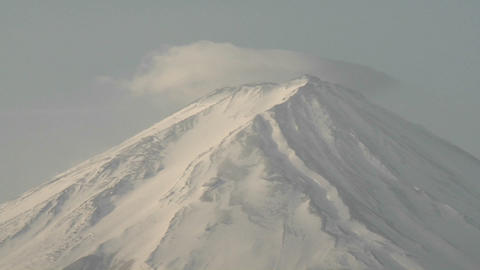 Time lapse of clouds streaming across Mt. Fuji, Japan Stock Video Footage