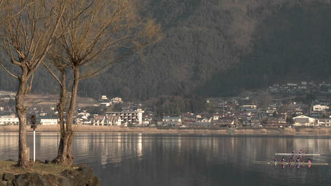 A team of rowers on the water of Lake Kawaguchi, Japan Stock Video Footage