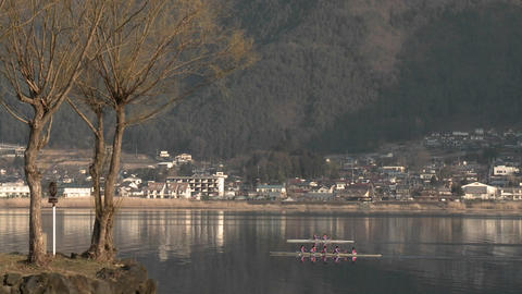 A team of rowers on the water of Lake Kawaguchi, Japan Footage