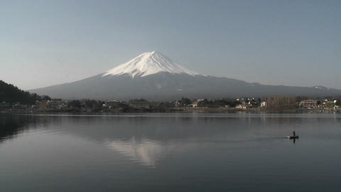 Mt. Fuji rises above a fisherman on Lake Kawaguchi, Japan Stock Video Footage