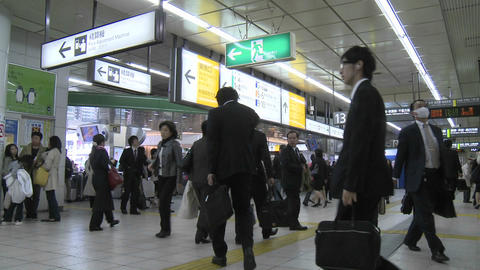 Commuters in a subway station during rush hour in Tokyo,... Stock Video Footage