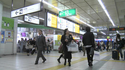 Commuters in a subway station during rush hour in Tokyo, Japan Footage