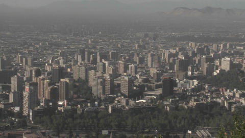 Pan across the smog filled city of Santiago, Chile Live Action