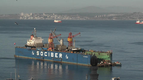 A floating dry dock in the harbor at Valparaiso, Chile Live Action