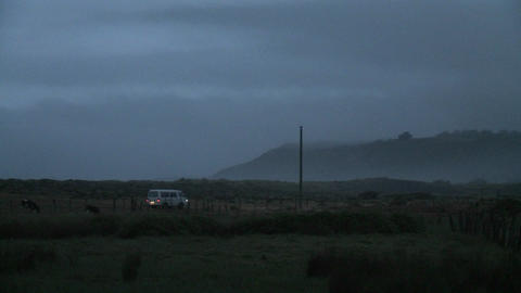 A van drives through Buchepureo, Chile, a tranquil village that is popular with surfers, at dusk Live Action