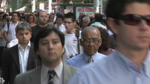 Foot traffic on Huerfanos, a pedestrian street in... Stock Video Footage