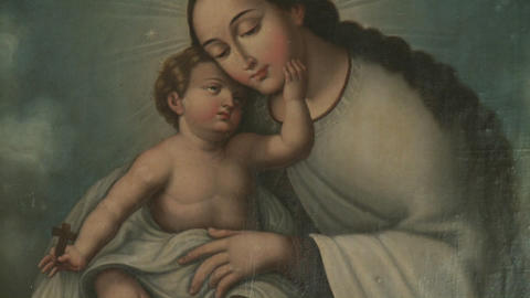 A vertical pan of a painting of Mary and Christ, located in Huilquilemu, a colonial estate that is n Footage