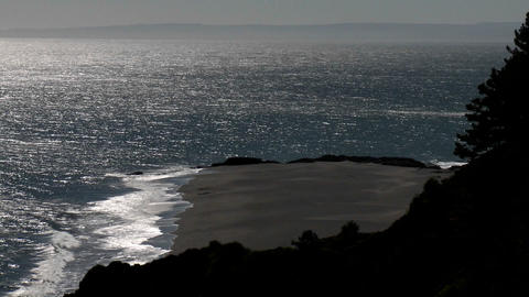 Horizontal pan over the ocean and coastline near... Stock Video Footage