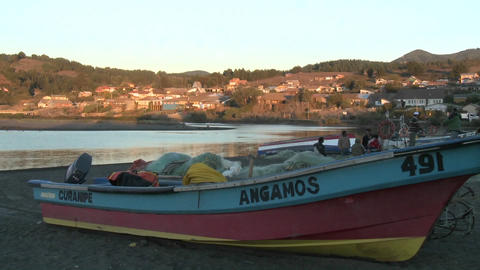 Fishing boats and fishermen on the beach at Curanipe, Chile Stock Video Footage