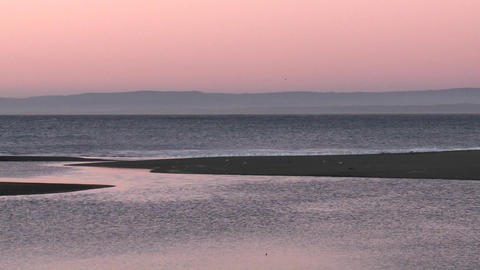 A colorful sunset over the Pacific Ocean at Curanipe, Chile Stock Video Footage
