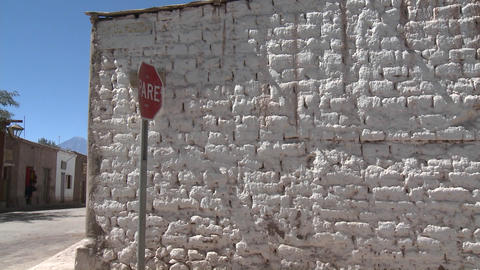 Pan across a whitewashed brick wall and the volcano... Stock Video Footage