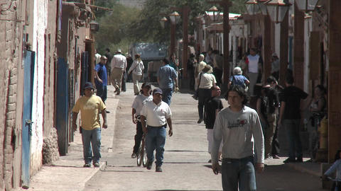 Slow move in on pedestrians in San Pedro de Atacama, Chile Footage