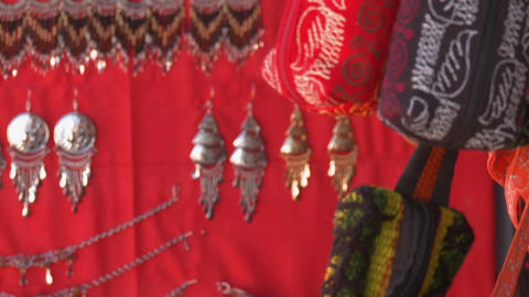 Slow move in on jewelry and fabrics for sale in a shop in... Stock Video Footage