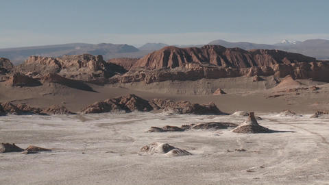 Pan across the Valley of the Moon and the Andes mountains near San Pedro de Atacama, Chile Footage