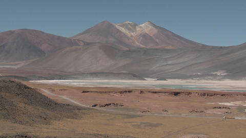 A truck passes through the colorful altiplano scenery... Stock Video Footage