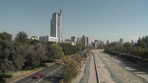 Pan across automobile traffic along the Rio Mapocho in Santiago, Chile Footage