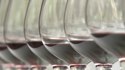Close up rack focus on a row of wine glasses Footage