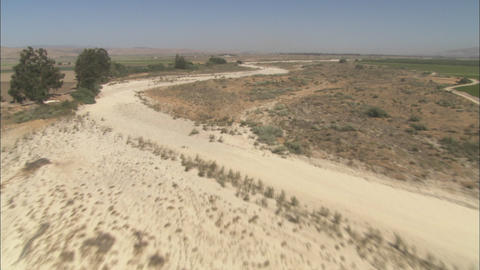 A low level helicopter aerial of the Rio Seco River in the Salinas Valley, California Footage