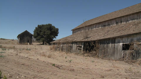 Pan across an old barn in the Salinas Valley, Monterey County, California Footage