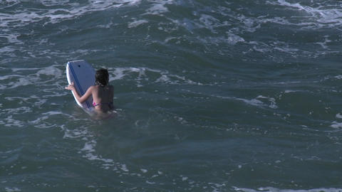 Boogie boarders in the surf at Pismo Beach, California Stock Video Footage
