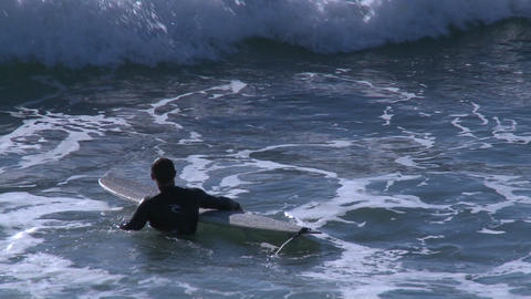 Surfers waiting for waves at Pismo Beach, California Stock Video Footage
