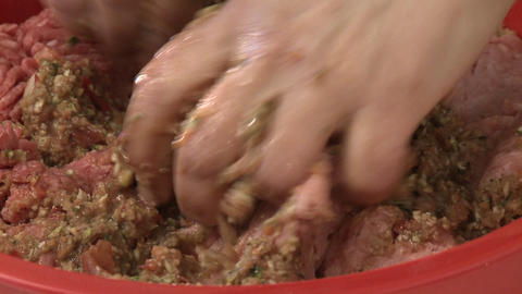 Close up of a woman's hands mixing raw ground turkey and... Stock Video Footage