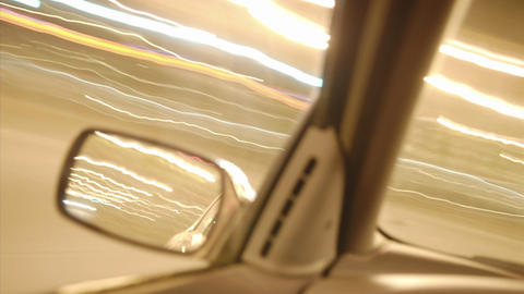A person drives a car through bright city streets Stock Video Footage