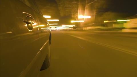 A car travels on a busy city street Stock Video Footage