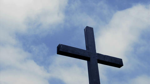 Clouds move in the sky above a wooden cross Stock Video Footage