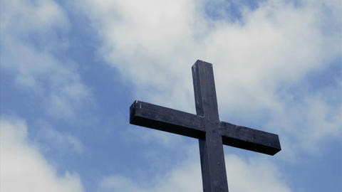 Clouds move in the sky above a wooden cross Footage