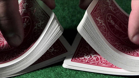 A deck of cards is shuffled in slow motion Stock Video Footage