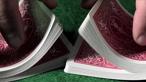 A deck of cards is shuffled in slow motion Footage