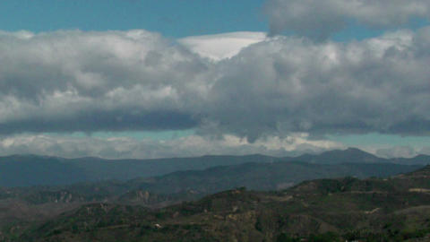 Time lapse of clouds over some mountains Stock Video Footage