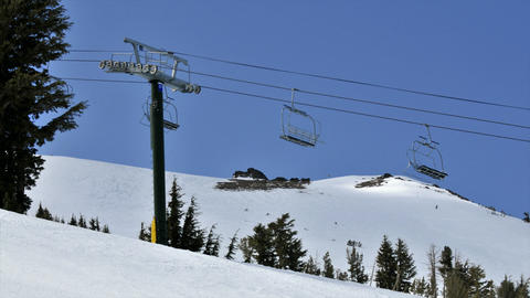 Time lapse of a chair lift at a ski resort Stock Video Footage