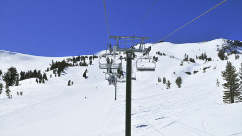 POV of someone riding up a ski lift in the mountains Stock Video Footage
